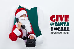 Santa on the phone announcing the start of holidays Royalty Free Stock Photo