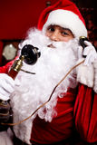 Santa with a phone Royalty Free Stock Photos