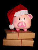Santa piggy bank and christmas presents Royalty Free Stock Photo