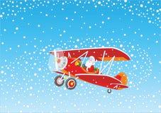 Santa piloting a plane Stock Image