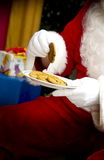 Santa with plate of cookies Stock Image