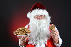 Santa With Plate of Cookies Royalty Free Stock Photography