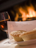 Santa Plate of Mince Pie Sherry and a Letter. With fire burning in the background Stock Images