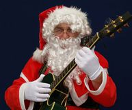Santa Playing Christmas Carols Stock Photos