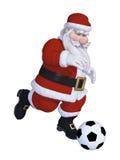 Santa playing football Stock Photography