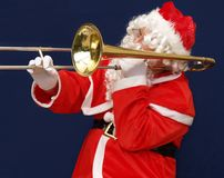 Santa playing the trombone Royalty Free Stock Image