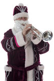 Santa plays the trumpet on a white Royalty Free Stock Images