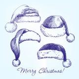 Santa pończochy kapeluszu ustalona ręka rysujący wektor Fotografia Stock