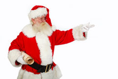 Santa pointing. Father christmas pointing  ideal copy space for text studio isolated shot on white Royalty Free Stock Photo