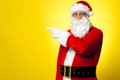 Santa pointing away towards something Royalty Free Stock Images