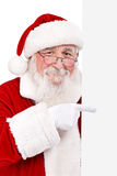 Santa pointing in blank banner Stock Image