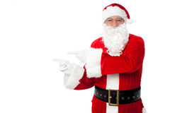 Santa pointing at blank copy space area Stock Images