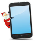 Santa Pointing Smartphone Stock Images