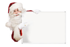 Santa Pointing To Blank Board Royalty Free Stock Images