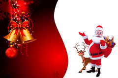 Santa pointing towards background with a gift bag Royalty Free Stock Photo