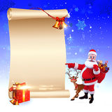 Santa pointing towards a big sign on blue backgrou Royalty Free Stock Photography