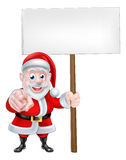 Santa Pointing at You with Sign. Santa wants or needs you Christmas cartoon of Santa Claus pointing at the viewer holding ablank sign. Could be asking for help Royalty Free Stock Photos