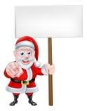 Santa Pointing at You with Sign Royalty Free Stock Photos