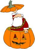 Santa Poking Out Of A Carved Pumpkin Stock Image