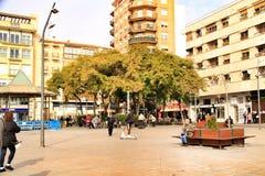 Square in the fishing village of Santa Pola. Santa Pola, Alicante, Spain- January 16, 2019: People walking around the Square of the fishing village of Santa Pola stock photography