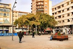 Square in the fishing village of Santa Pola. Santa Pola, Alicante, Spain- January 16, 2019: People walking around the Square of the fishing village of Santa Pola royalty free stock photos