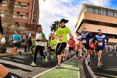Santa Pola, Spain- January 20, 2019: Runners in the Half Marathon of the fishing village of Santa Pola, province of Alicante, on a stock photos