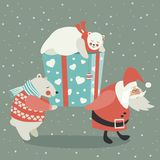 Santa and polar bear carrying a gift Royalty Free Stock Photography
