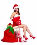 Santa pomagiera Bożenarodzeniowa dziewczyna z teraźniejszość. Zdjęcia Stock