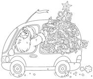 Santa porte un arbre de Noël Image stock