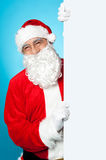 Santa posing beside long blank banner ad Stock Photos