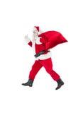 Santa positiva com um saco e os polegares acima Imagem de Stock Royalty Free