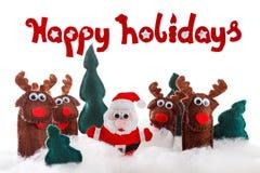 Santa, poupées de cerfs communs dans la neige pour Noël, Noël dessus Photo stock