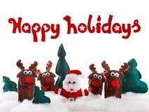 Santa, poupées de cerfs communs dans la neige pour Noël, Noël sur le blanc Photo libre de droits