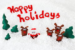 Santa, poupées de cerfs communs dans la neige pour Noël, Noël sur le blanc Photographie stock