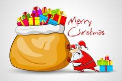 Santa poussant le sac complètement de cadeau de Noël Photos libres de droits