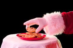 Santa prenant le biscuit photographie stock