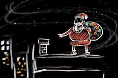 Santa prepara i regali per i bambini Fotografie Stock Libere da Diritti