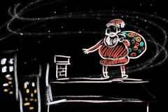 Santa prepares gifts for children. Christmas Santa prepare into chimney Royalty Free Stock Photos
