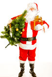 Santa with present and christmas tree Stock Photo