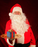 Santa With Present on Tray Royalty Free Stock Photos