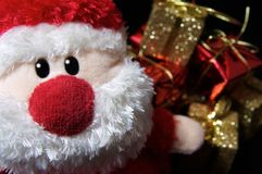 Santa + presente Fotografia Stock