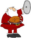 Santa Presenting A Cooked Turkey Royalty Free Stock Image