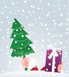 Santa Presenting a Gift Stock Image