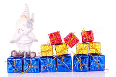 Santa and the presents. Santa claus figure on presents in line on white background Stock Images