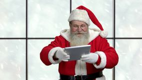 Santa presents computer tablet with blank space. stock video