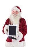 Santa presents a tablet PC Stock Photo