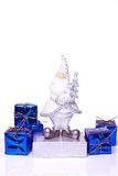 Santa with presents on white. Santa claus figure with presents on white background Royalty Free Stock Images