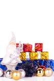 Santa with presents and xmas balls. Santa claus figure with presents and xmas balls on white background Stock Photo
