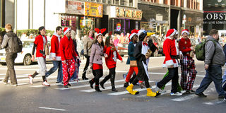 Santa Pub Crawl, Manhattan, NYC. New Yorkers dressed in Christmas costumes participate in the 2012 Santa Pub Crawl throughout Manhattan, NYC Stock Photos
