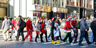 Santa Pub Crawl, Manhattan, NYC. New Yorkers dressed in Christmas costumes participate in the 2012 Santa Pub Crawl throughout Manhattan, NYC Royalty Free Stock Photo